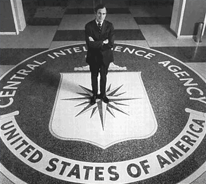 George Bush standing on CIA seal